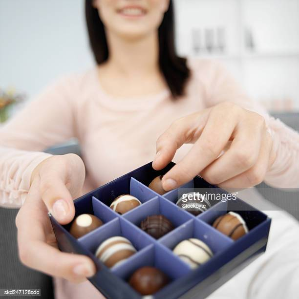 Woman enjoying a box of chocolates