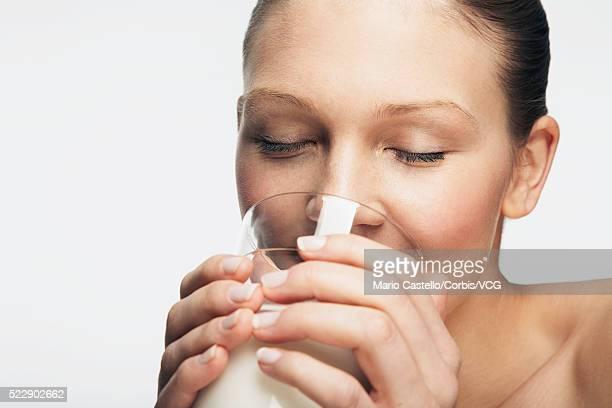 Woman enjoying a glass of a milk