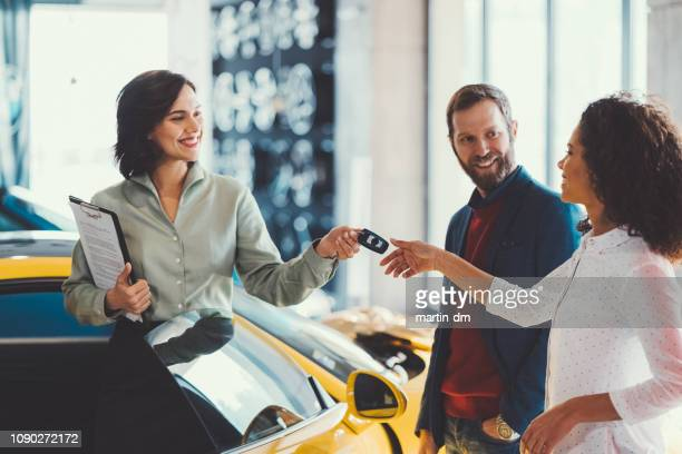 woman enjoying a new car - new stock pictures, royalty-free photos & images