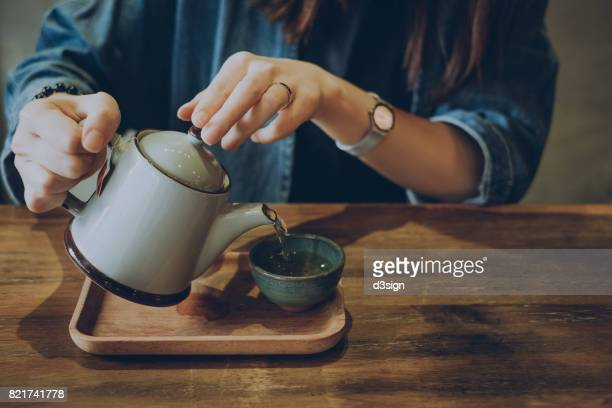 Woman enjoying a quiet time with a fresh cup of tea