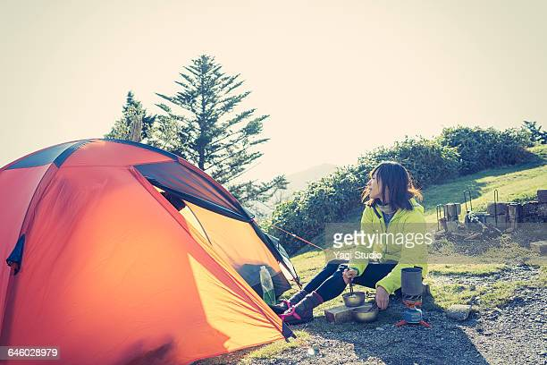 Woman enjoying a tent camp in mountain