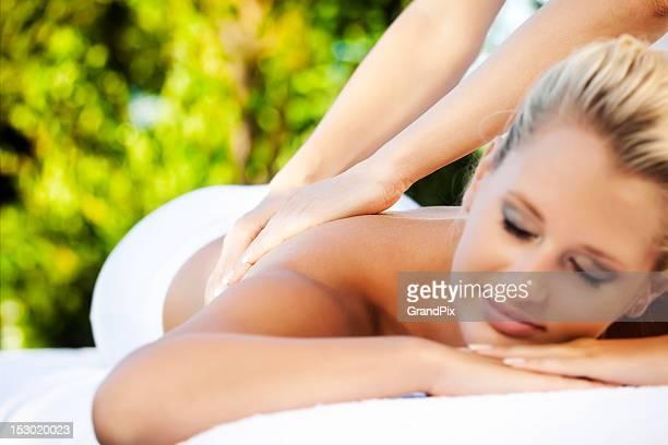 A woman enjoying a tropical massage