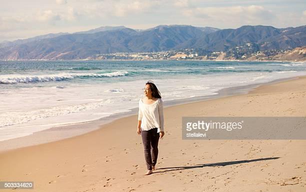 Woman enjoying a walk at Santa Monica Beach