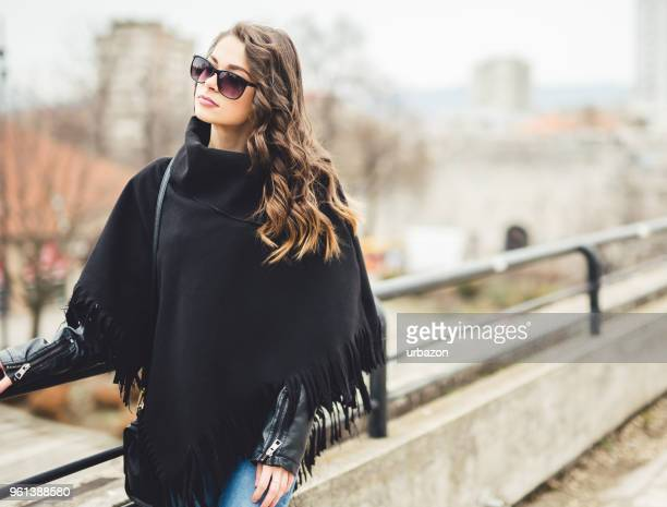 woman enjoying a walk in the beautiful day. - poncho stock pictures, royalty-free photos & images