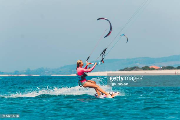 woman enjoying aquatic sports in the summer - kiteboarding stock photos and pictures