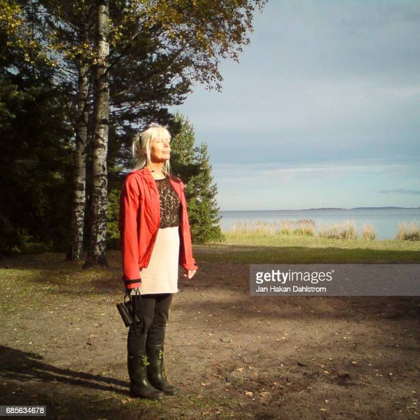 woman enjoying autumn sun - bleached hair stock pictures, royalty-free photos & images