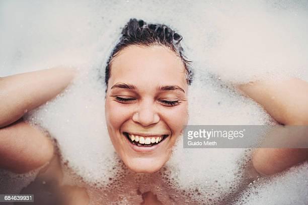 Woman enjoying bath.