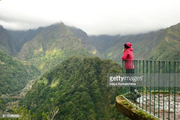 woman enjoying beautiful scenery at madeira island, atlantic ocean, portugal - madeira fotografías e imágenes de stock