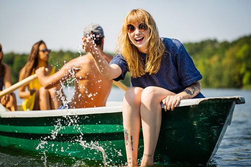 Woman enjoying boat ride in lake - gettyimageskorea