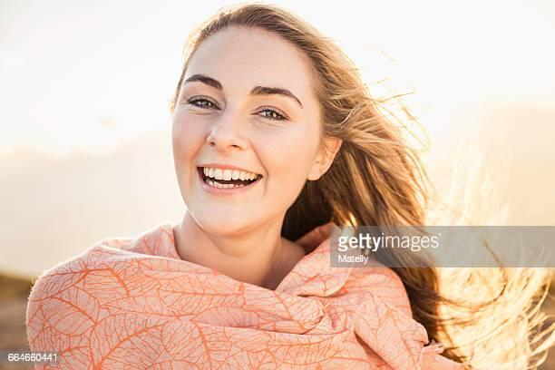 Woman enjoying breeze on sunny day