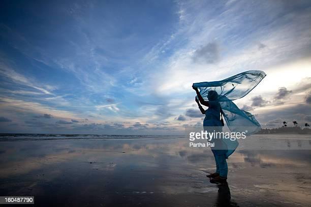woman enjoying breeze,seabeach,mandarmani - dupatta stock pictures, royalty-free photos & images