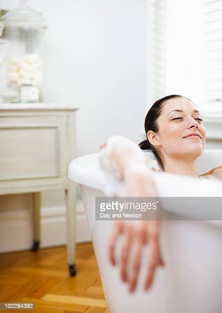 woman enjoying bubble bath - indulgence stock pictures, royalty-free photos & images