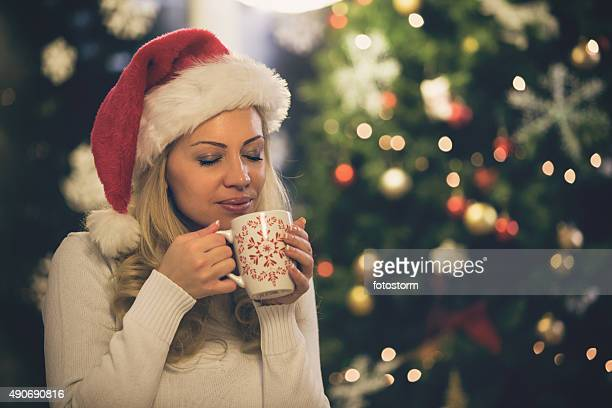Woman enjoying coffee at Christmas