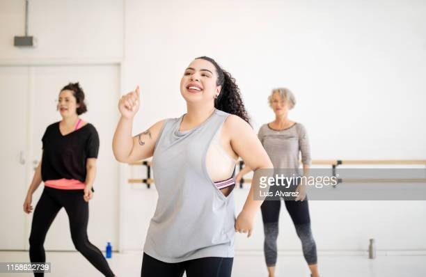 woman enjoying dancing at health center - fat lady in leggings stock photos and pictures