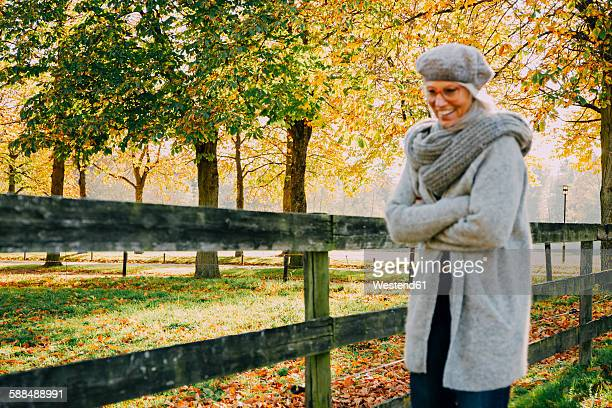 Woman enjoying day at autumnal park