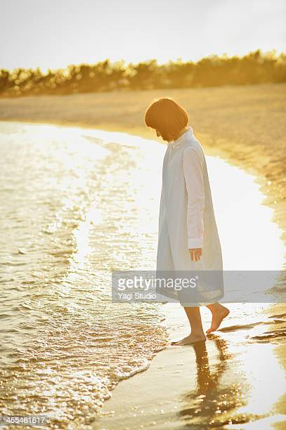 Woman enjoying day out at the beach