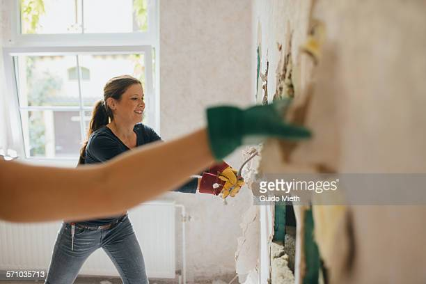 woman enjoying demolition. - demolishing stock pictures, royalty-free photos & images