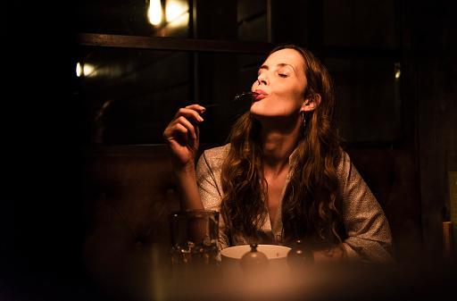 Woman enjoying dinner - gettyimageskorea