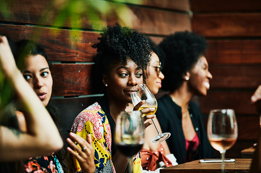 Woman enjoying drink with friends at poolside bar - gettyimageskorea