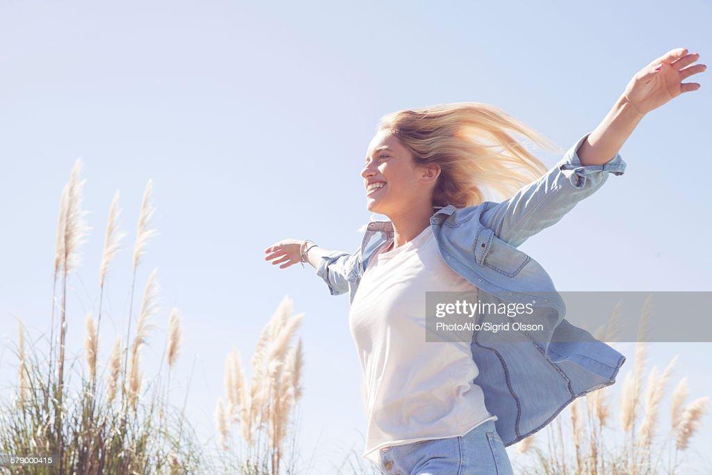 Woman enjoying fresh air outdoors : Stock Photo