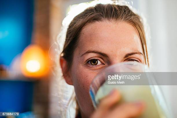 Woman enjoying fresh smoothie.