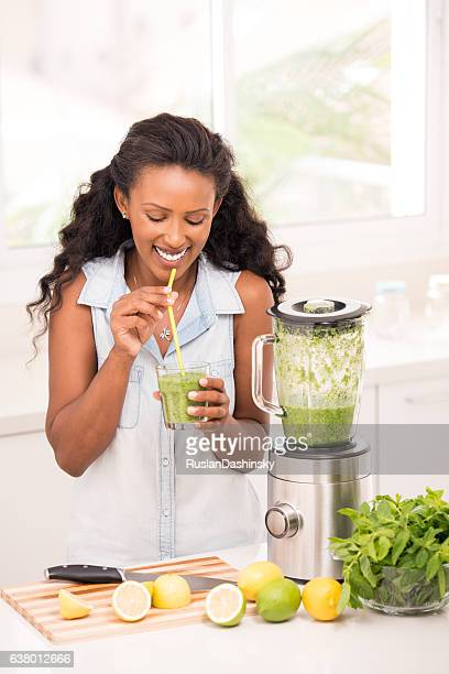 Woman enjoying frozen lemonade.