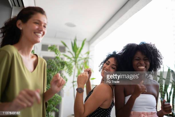 woman enjoying good times together - polyamory stock photos and pictures