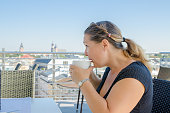 woman enjoying her cup coffee with