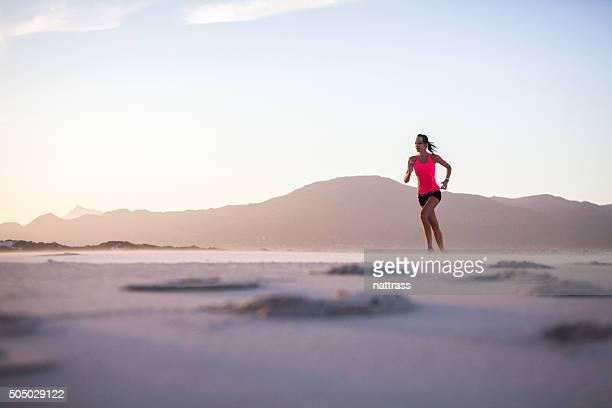 Woman enjoying her early morning sunrise run