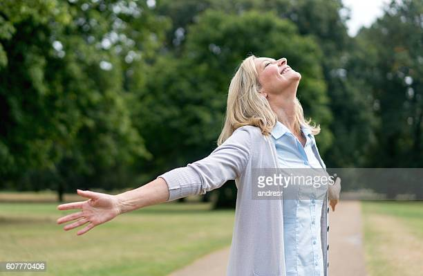 Woman enjoying her freedom at the park