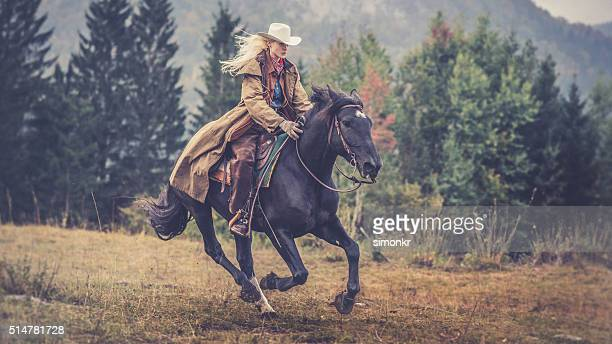 woman enjoying horse riding - cowboy hat stock pictures, royalty-free photos & images