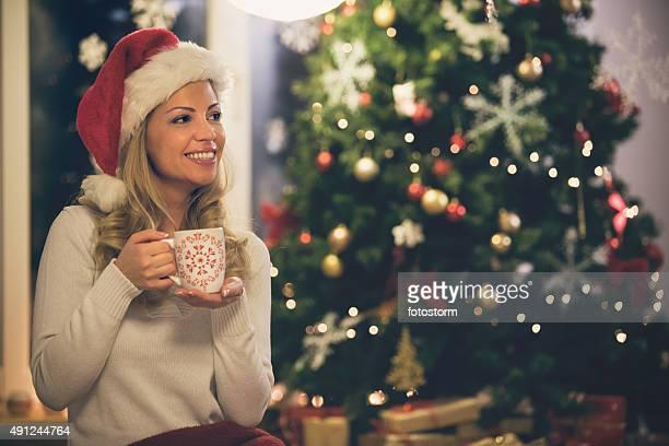Woman enjoying hot coffee during Christmas holidays