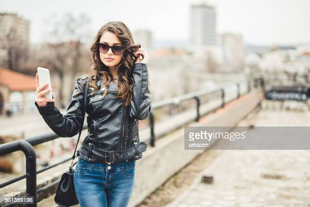 Woman enjoying  in beautiful day and make selfie with her mobile phone.