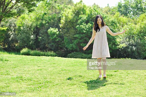 woman enjoying in nature - green dress stock pictures, royalty-free photos & images