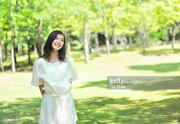 woman enjoying in nature - 若い女性一人 ストックフォトと画像