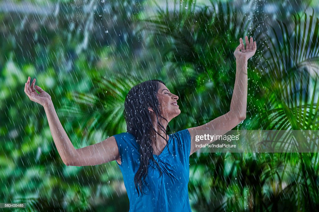 Woman enjoying in the rain : Stock Photo