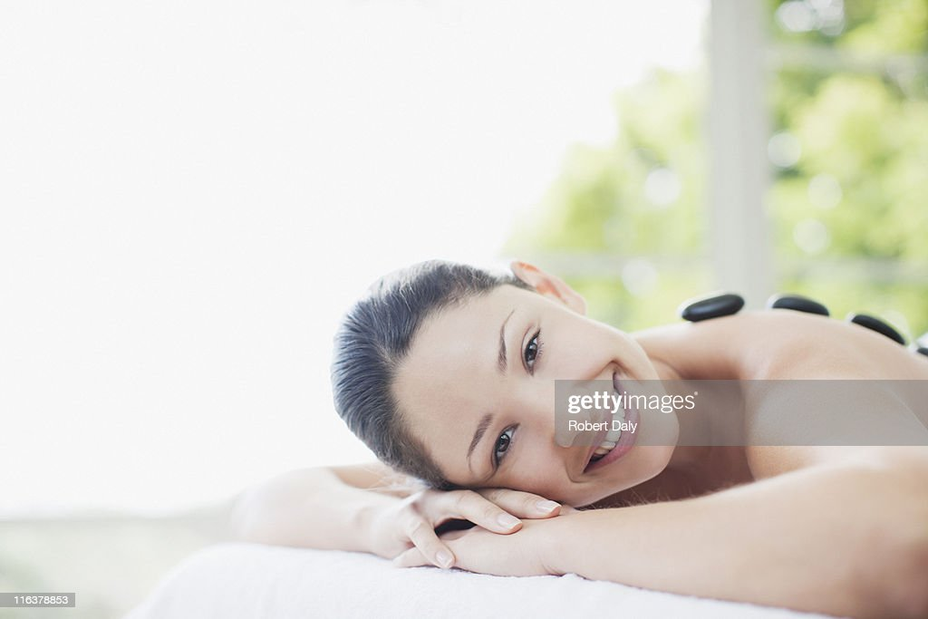 Woman enjoying lastone therapy : Stock Photo
