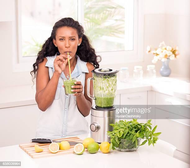 Woman enjoying lemonade.
