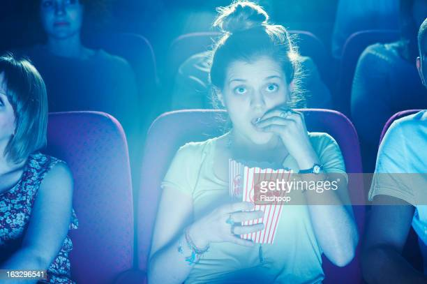 woman enjoying movie at cinema - indústria cinematográfica - fotografias e filmes do acervo