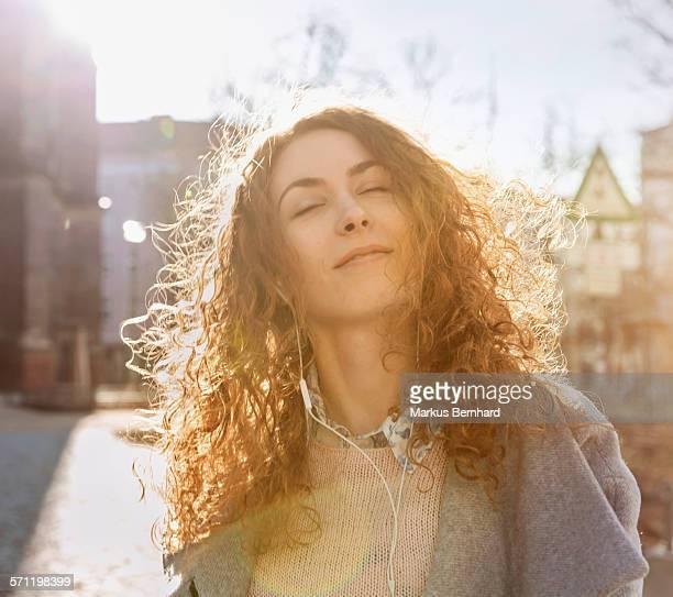 Woman enjoying music on headphone.