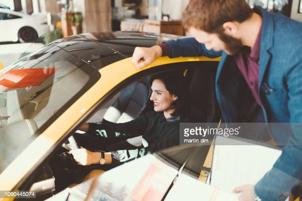 woman enjoying new car - land vehicle stock pictures, royalty-free photos & images
