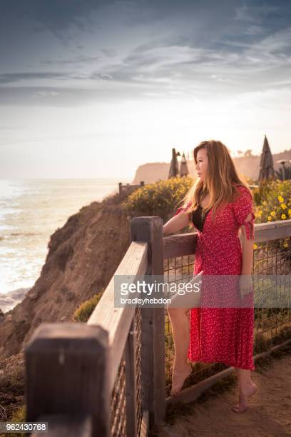 Woman enjoying ocean view from cliffs along Rancho Palos Verdes, CA