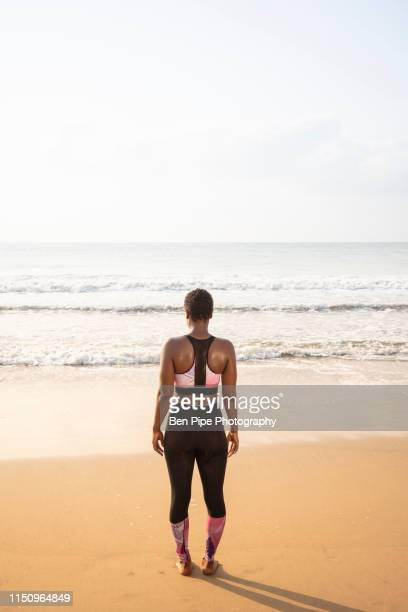 woman enjoying ocean view - ghana independence stock pictures, royalty-free photos & images