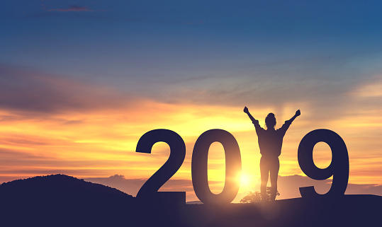 Woman enjoying on the hill and 2019 years while celebrating new year 921527002