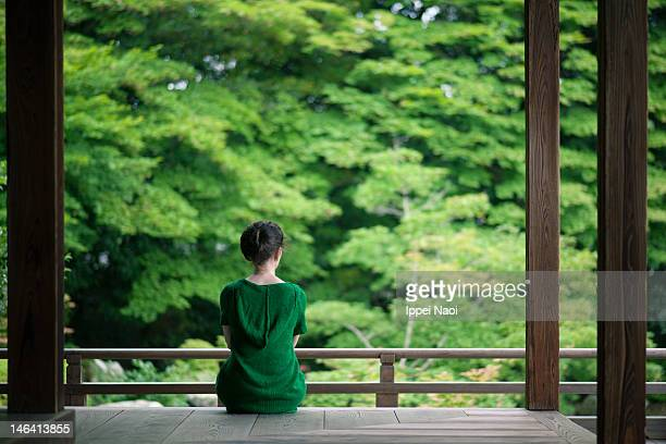 Woman enjoying peaceful moment in Kyoto