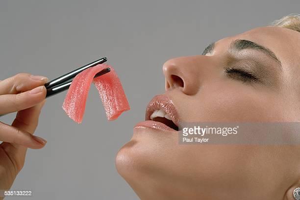 Woman enjoying piece of sashimi