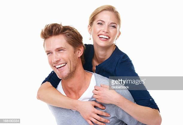 Woman enjoying piggyback ride with man