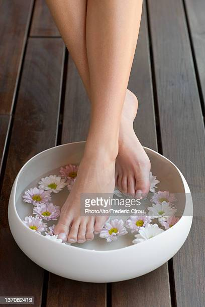Woman enjoying relaxing foot bath