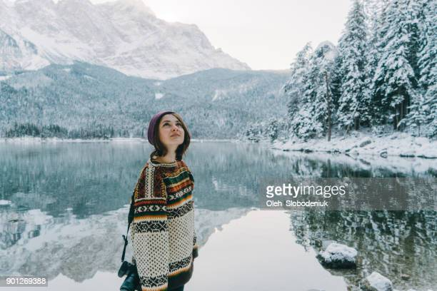 woman enjoying scenic view of eibsee lake in alps - mere noel stock pictures, royalty-free photos & images