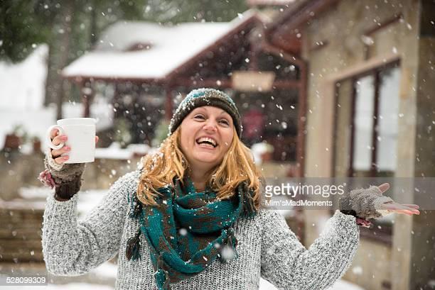 woman enjoying snow fall - 指なし手袋 ストックフォトと画像